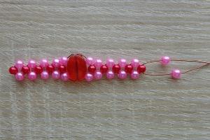 piros-rózsaszín gyűrű